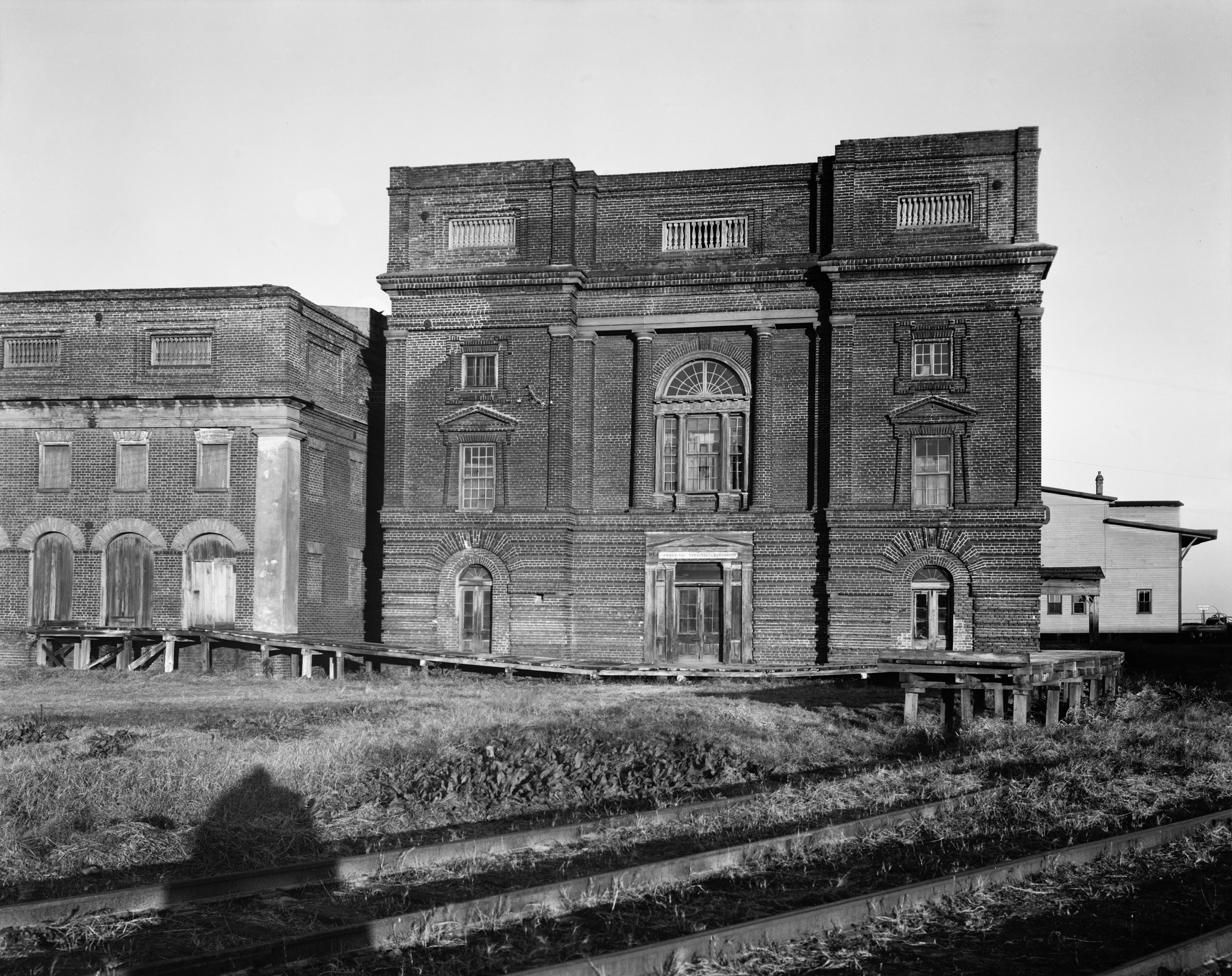 Bennett's wealth allowed him to create a building for milling rice that was both utilitarian and a masterpiece blending Classical Revival and Italian Renaissance styles. Bennett Rice Mill, circa 1937,  by Frances Benjamin Johnston