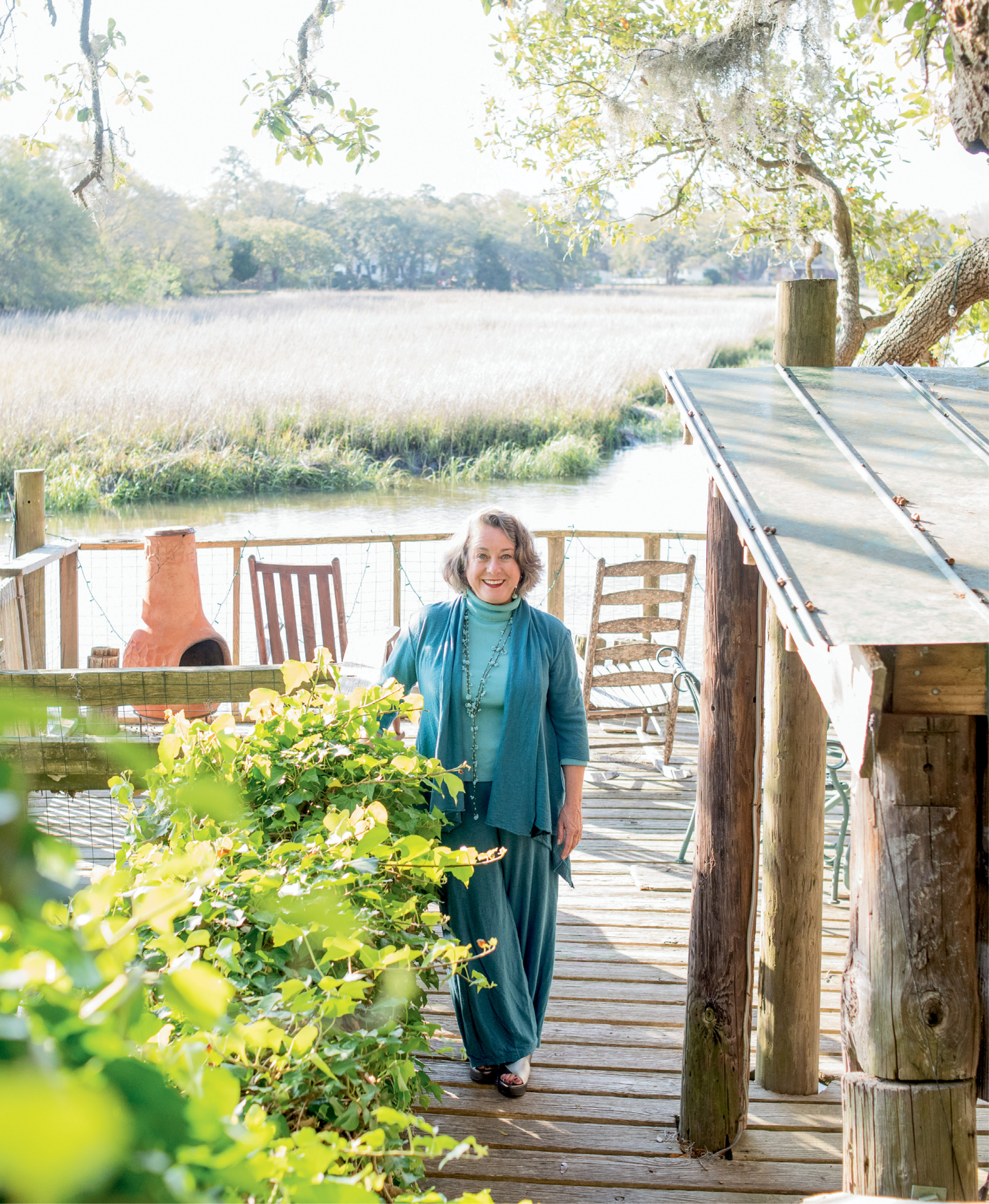 """I love to be outdoors,"" says artist Mary Edna Fraser, pictured here on the dock of the James Island tidal creek property where she lives and works."