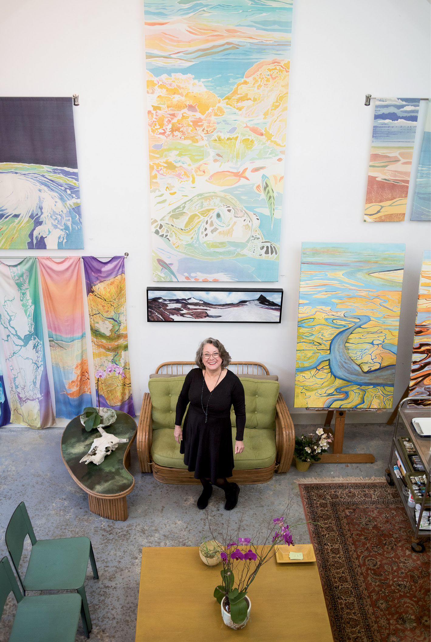"Looking Up: Fraser (photographed in her studio) brings an aerial perspective to her works, giving viewers a broader understanding of how human actions impact the landscape. ""I go where I feel I'm most needed,"" she says, in choosing her subject matter."