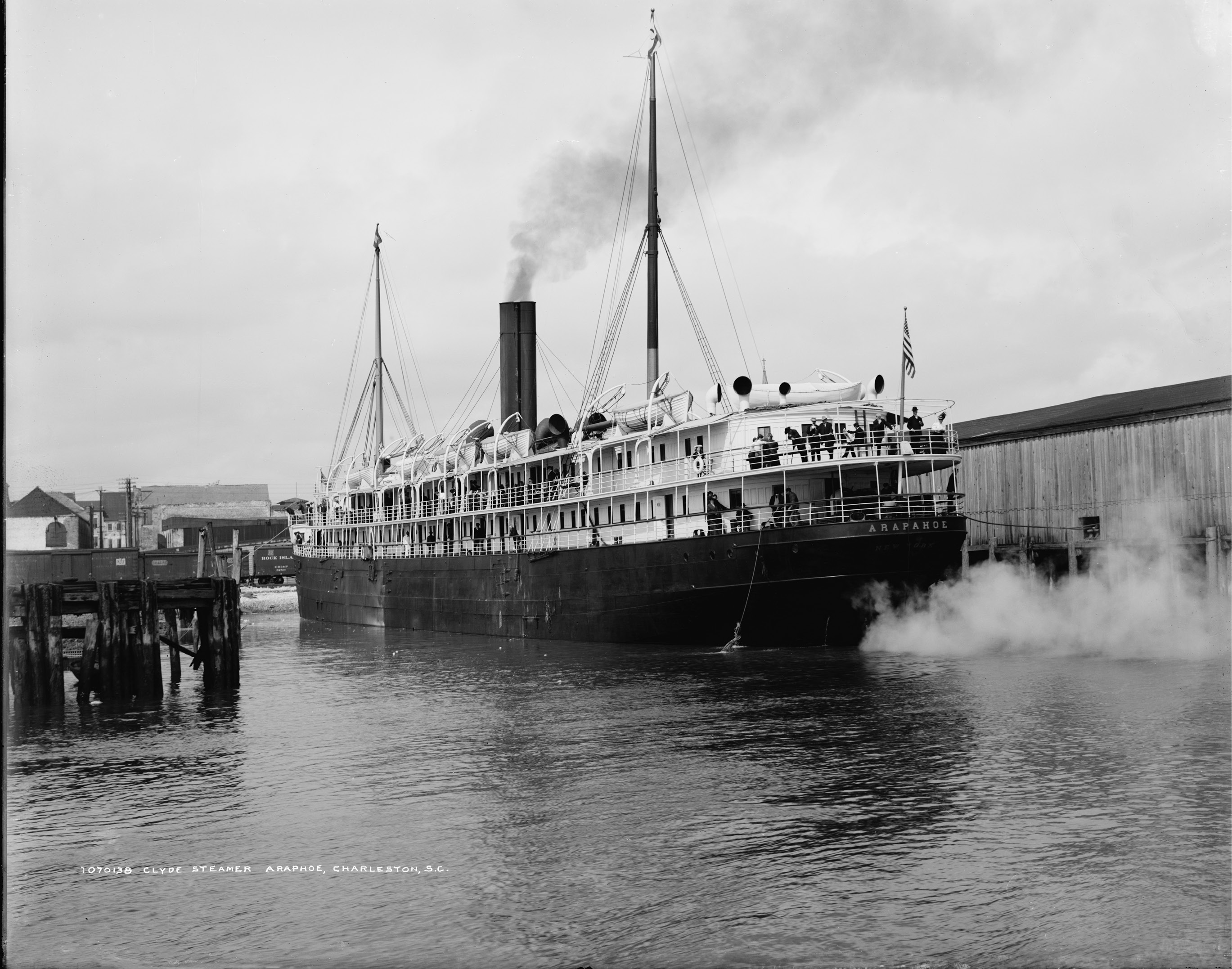 "The Clyde ships ran regularly between Charleston, Philadelphia, and New York, docking at the wharves at the foot of Queen Street. The amenities they touted included cabins finished in oak; an exceptionally attractive social hall ""finished in cream and gold, having an upright piano, velvet cushioned sofas;"" and the most modern invention of all—electric lights throughout. Clyde Steamer Arapahoe, circa 1900, from Detroit Publishing Co."