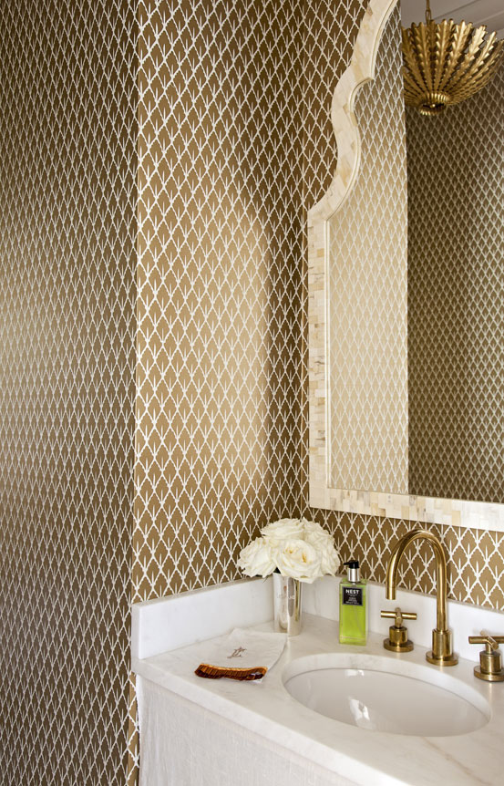In this petite powder room, Schumacher wallpaper makes a bold statement without overwhelming the eye.