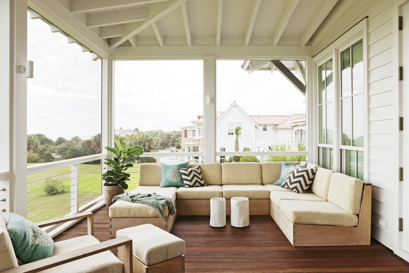 Furniture maker Brian Hall also made the teak porch sectional.