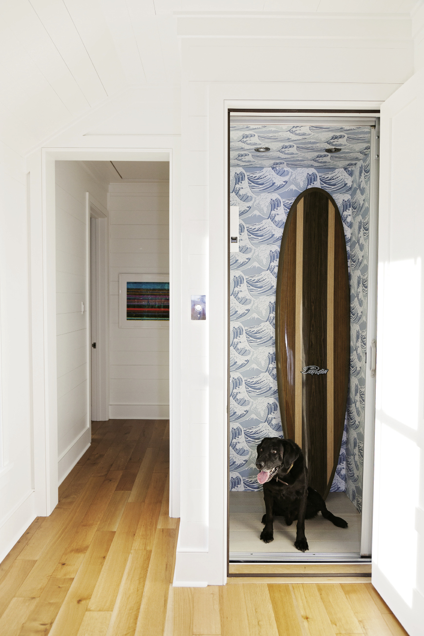 A wallpapered elevator is available for tired surfers.