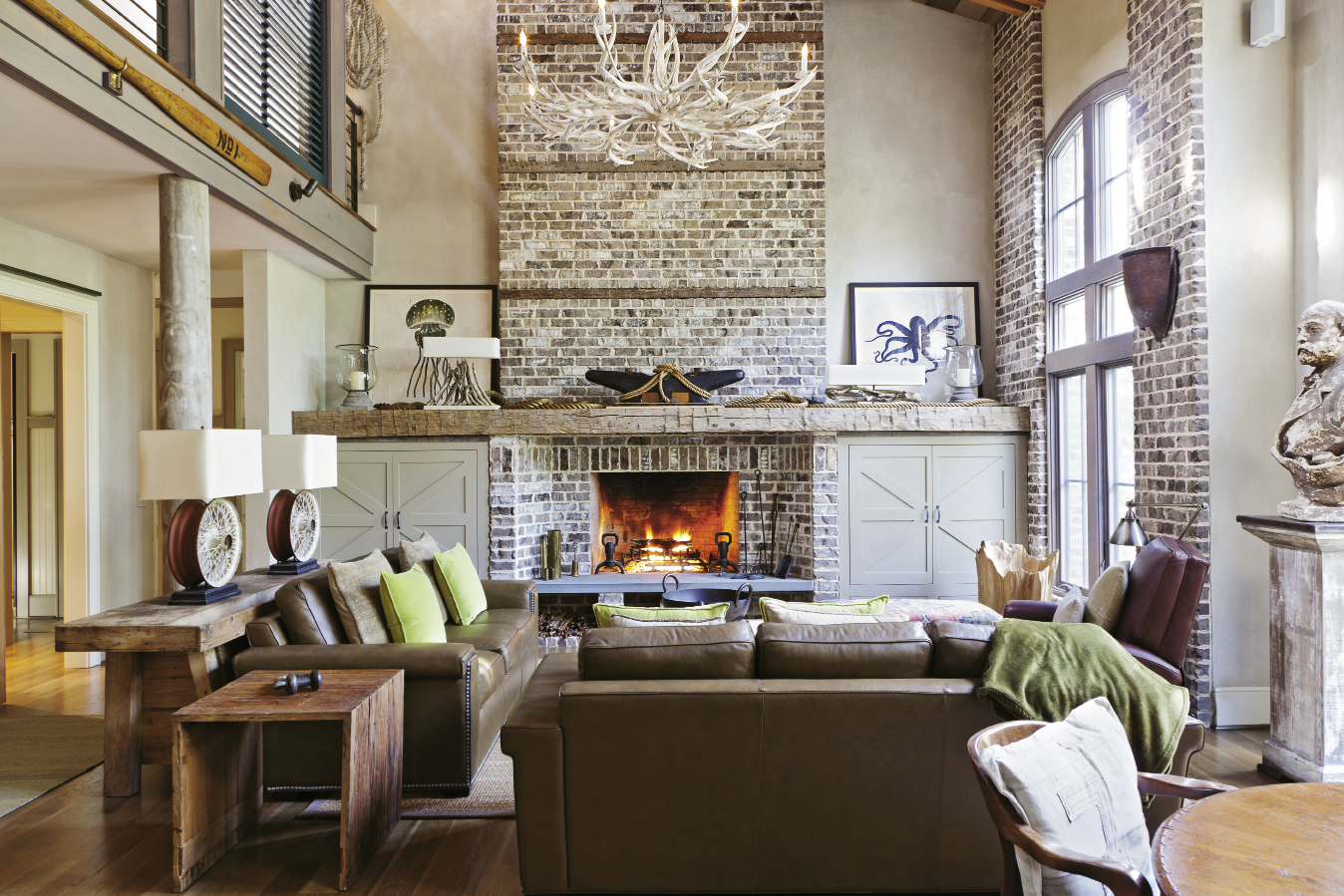 High ceilings and exposed brick recall downtown's historical cotton warehouses. Industrial details, such as iron railings, and nautical touches, such as the anchor and ropes displayed on the mantel, are touchstones of the owners' personal style.