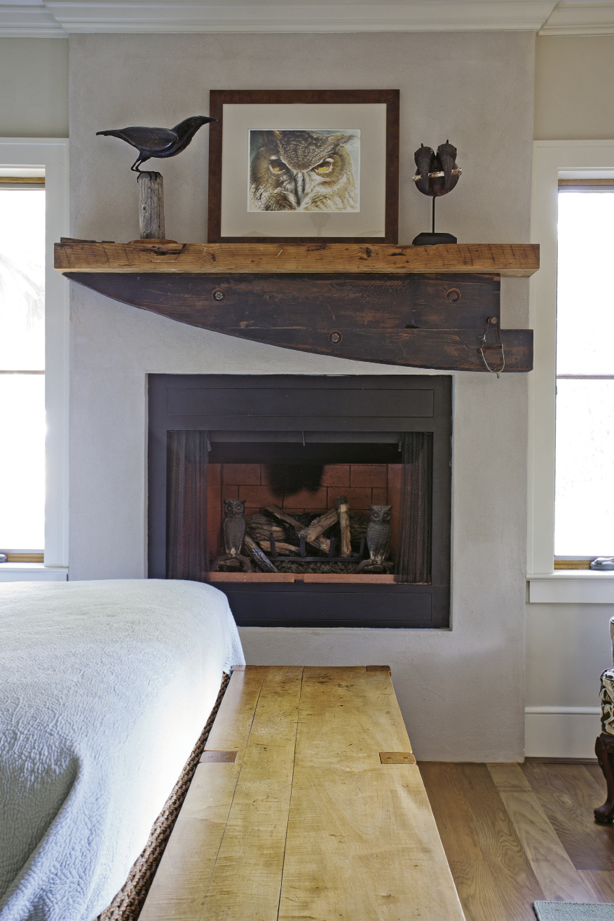A hunk of wood found roadside on the Charleston Neck was revamped into a fireplace mantel in the first-floor bedroom.