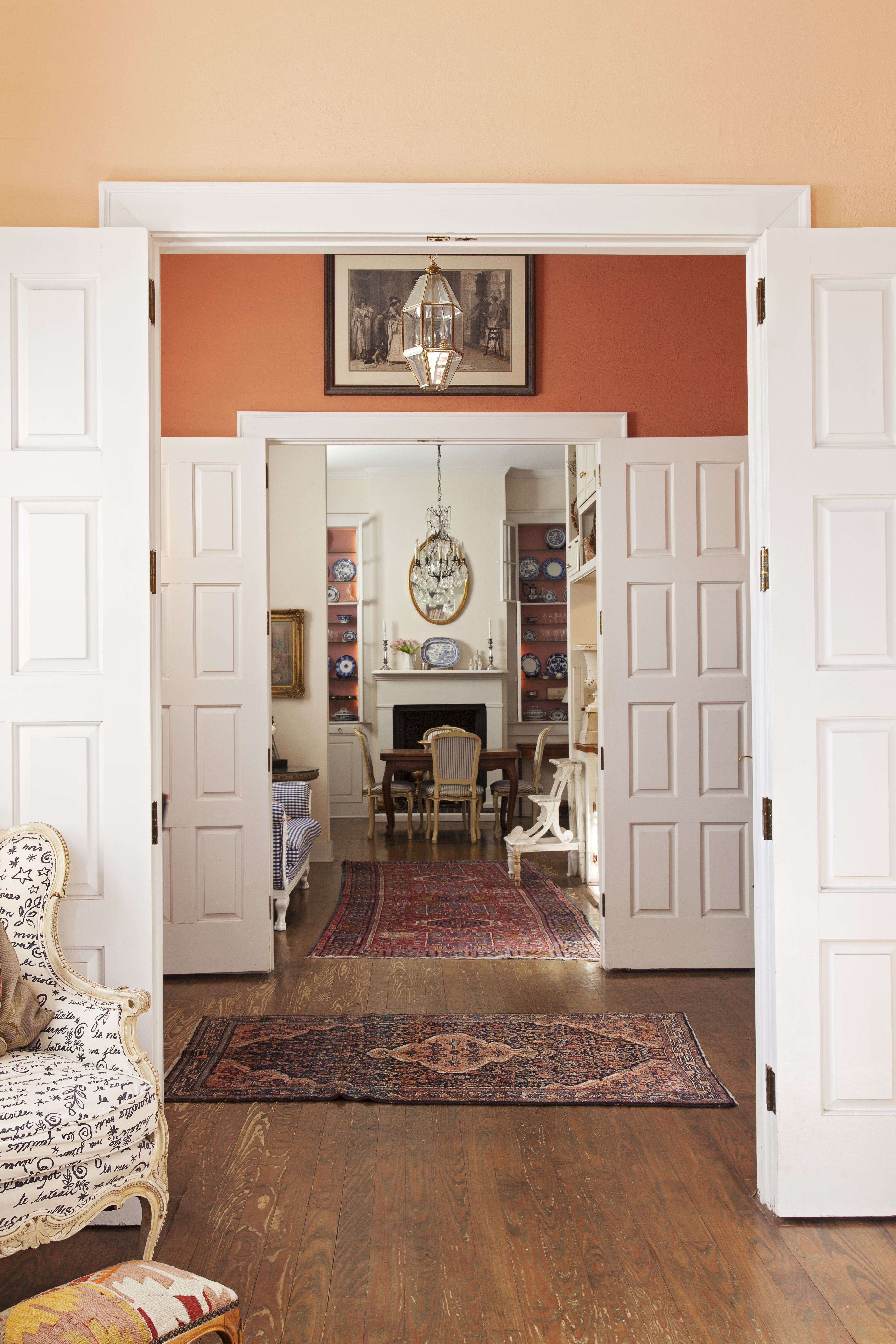 Paneled wood doors allow the space to be at turns intimate and airy.