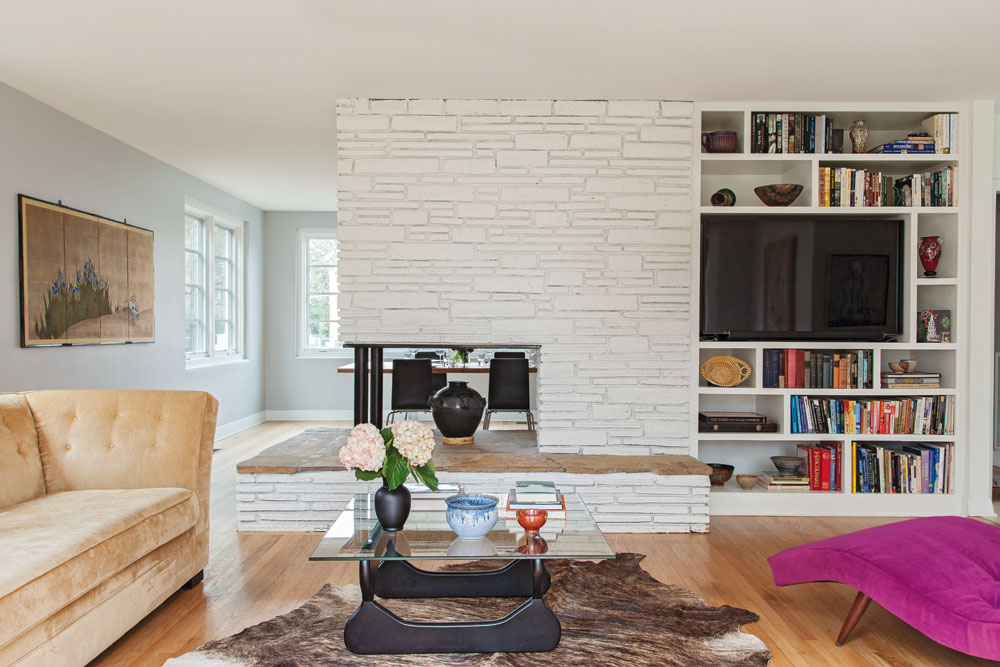 And built-in storage was added—its shelves vary in size to mimic the patterns of brick in the fireplace.