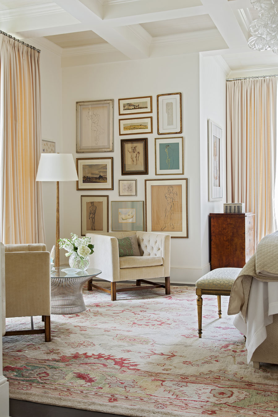 neutral territory: The graceful, first-floor master bedroom is both elegant and modern with ivory drapery and an array of artwork.