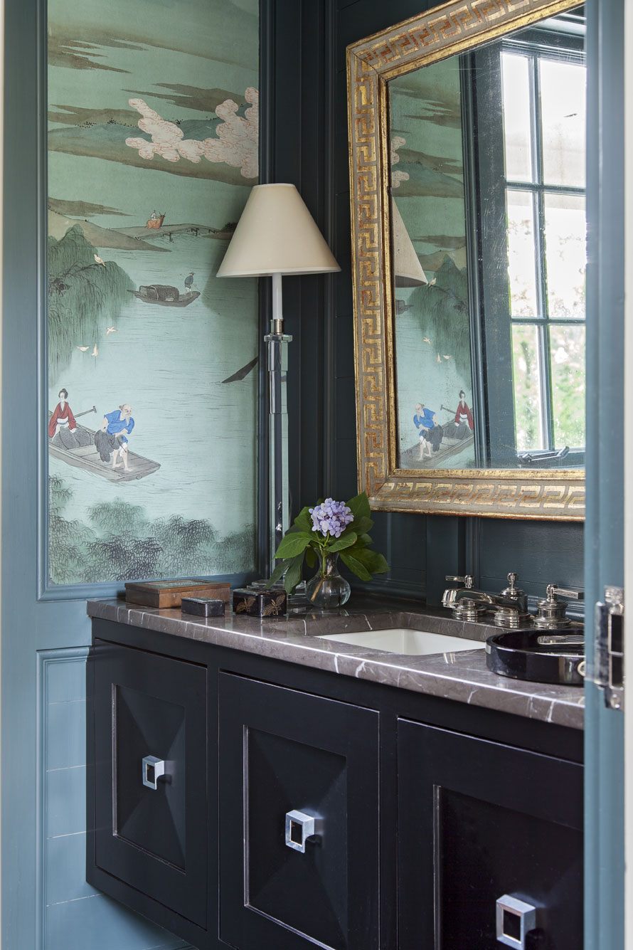 """reinvented: Hand-painted panels that Sarah-Hamlin's grandmother had commissioned during a trip to China find a new home in the first-floor powder room, where they look fresh against walls painted """"Amazon Green"""" by Benjamin Moore."""