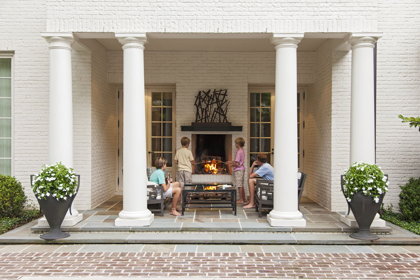 COMFORT ZONE: On fall evenings, the whole gang gathers around the outdoor fireplace to catch up on the day's events (above).