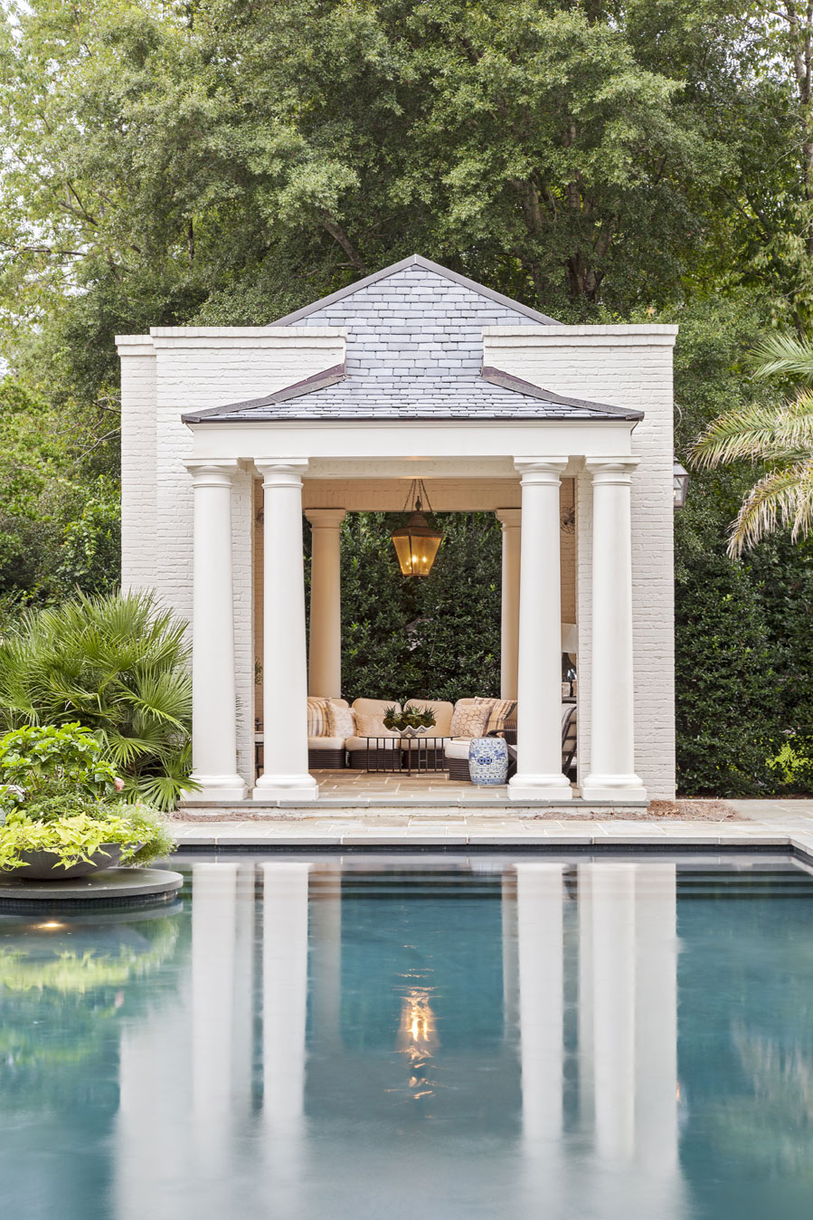 CABANA COOL: Elevated pool cabanas provide shade and a place to relax (top). A landscaped brick wall acts as a privacy screen as the Hastings boys face off in the pool for a game of chicken.