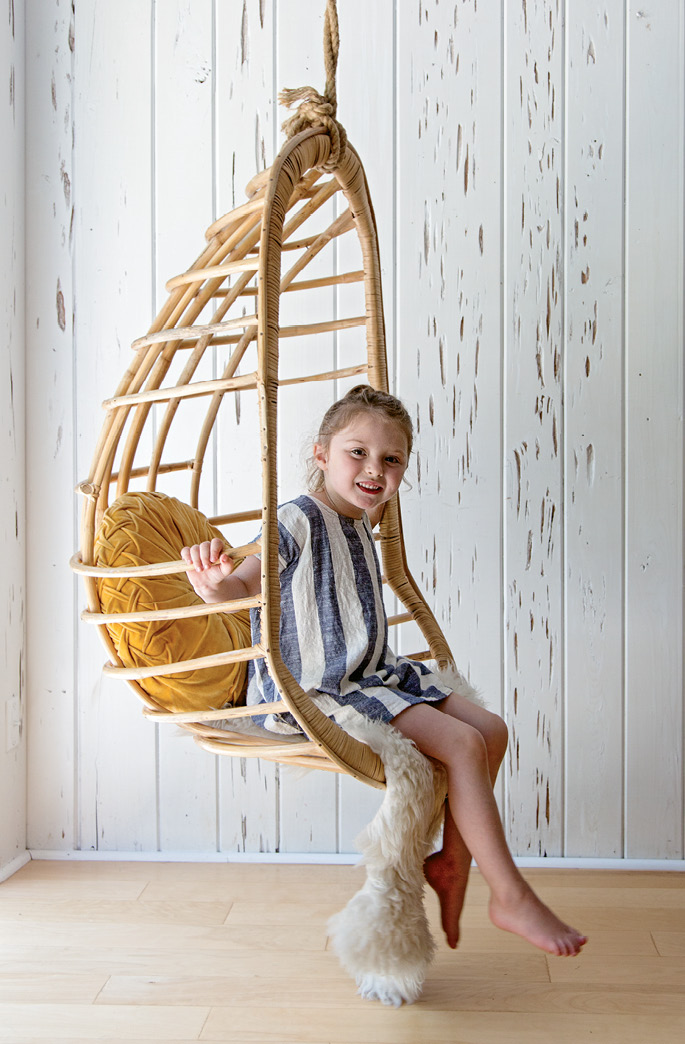 Sunny enjoys the cool hanging swing from Eclectic Charleston