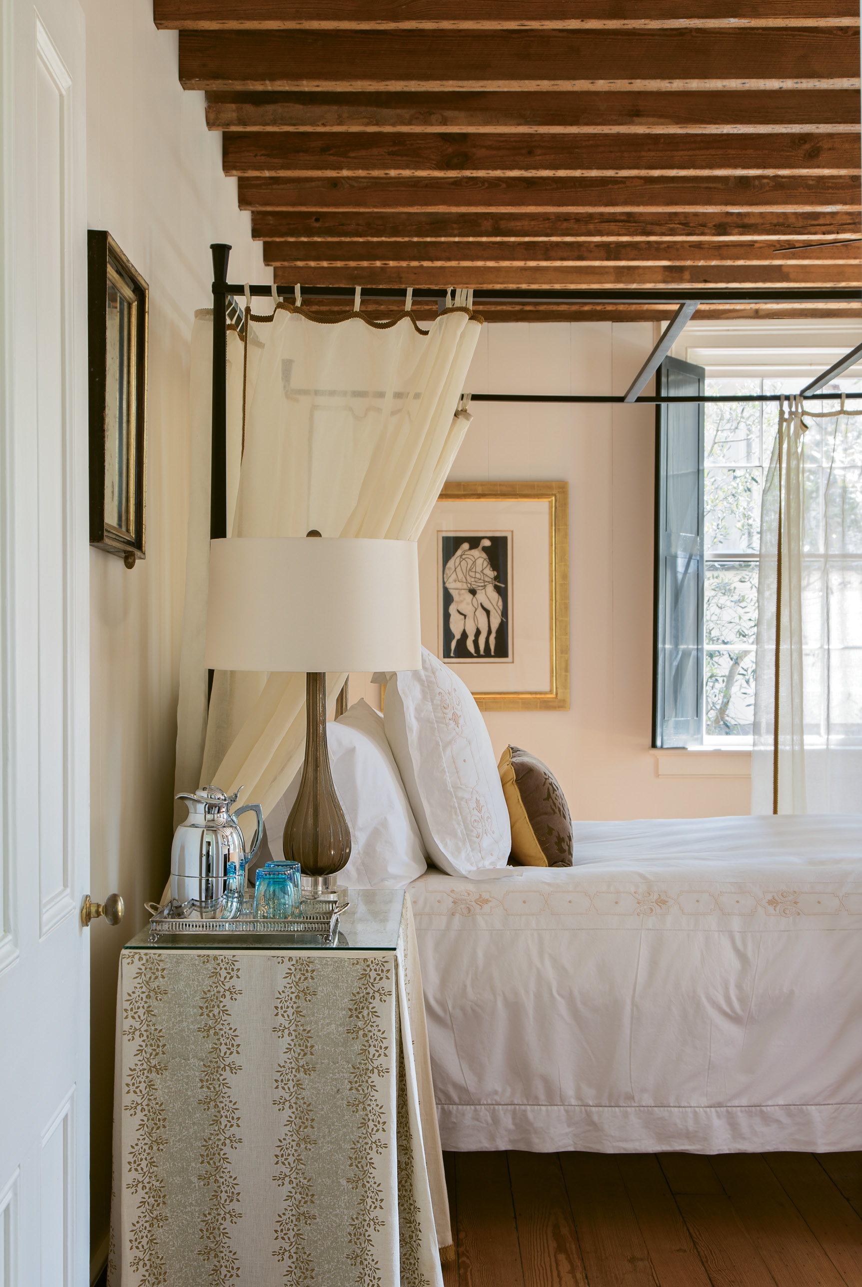 The separate guest quarters, located within what was once a detached kitchen house, feature original exposed wood beams and wood flooring.