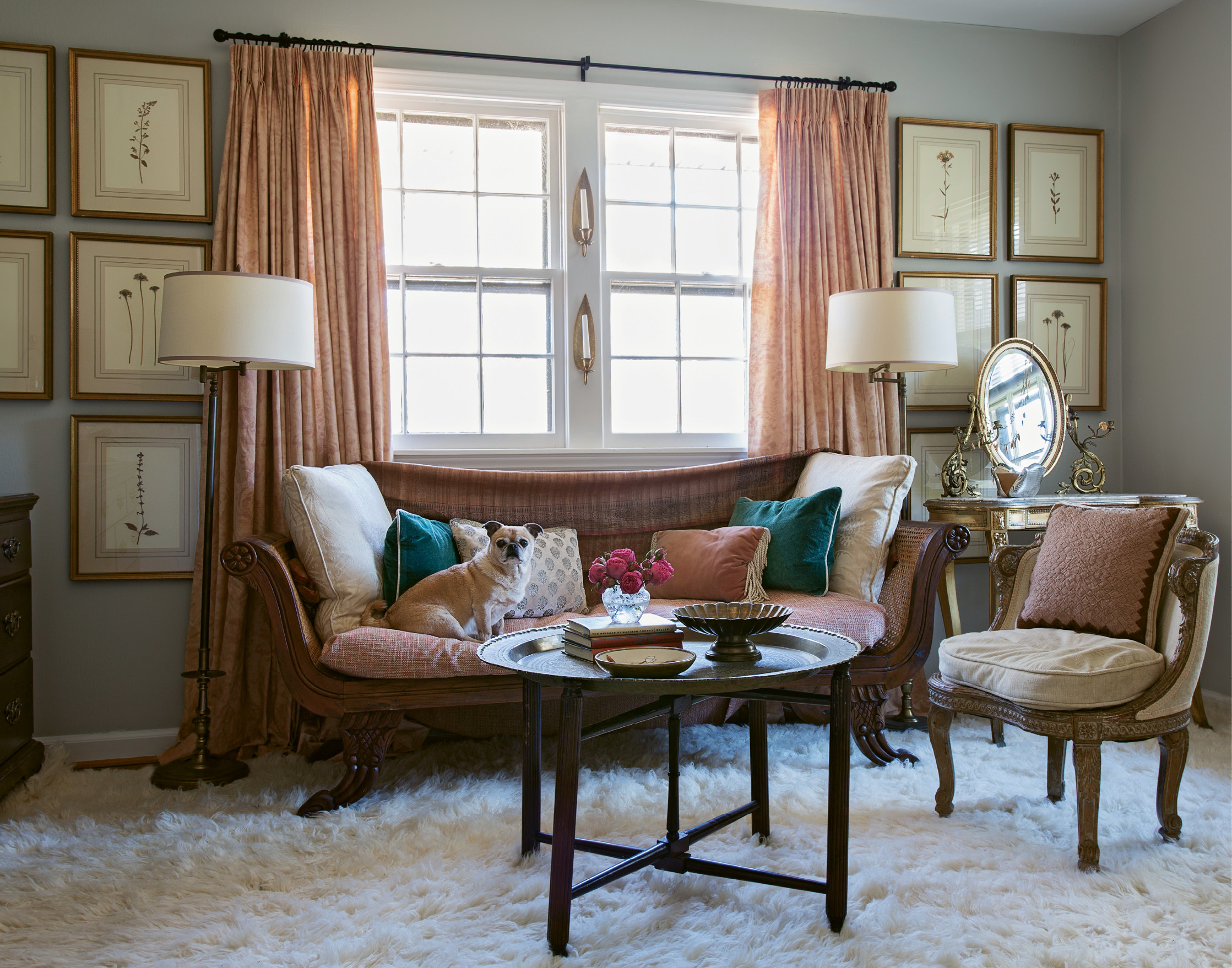 Lady's Lounge: A vintage Italian settee and textiles in dusty pinks and creams—with a few pops of peacock blue—set a ladylike tone in Tinkler's dressing room. On the wall, a large grouping of pressed botanicals in gilt frames adds a sense of dimension.