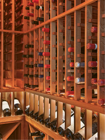 CROWN JEWEL: Tucked into the brick wall of the kitchen, the petite wine cellar holds 950 bottles.