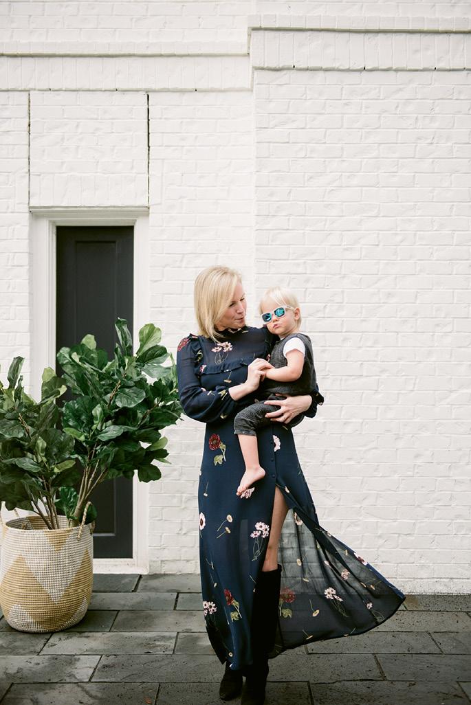 Molly with son Fox in Babiators shades