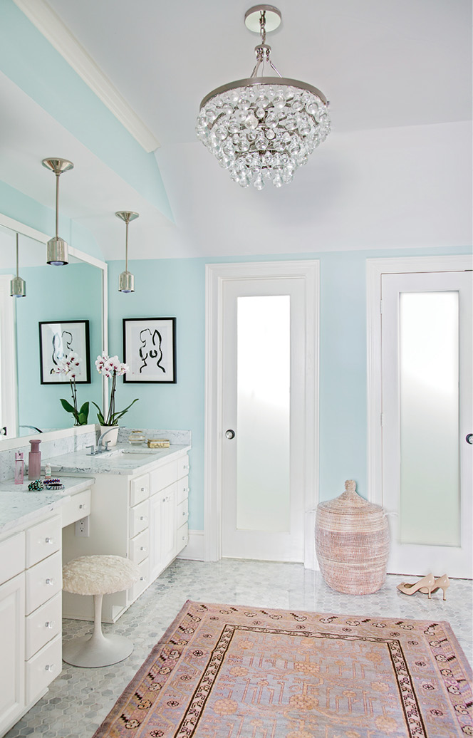 An area rug brings character to the otherwise modern master bath