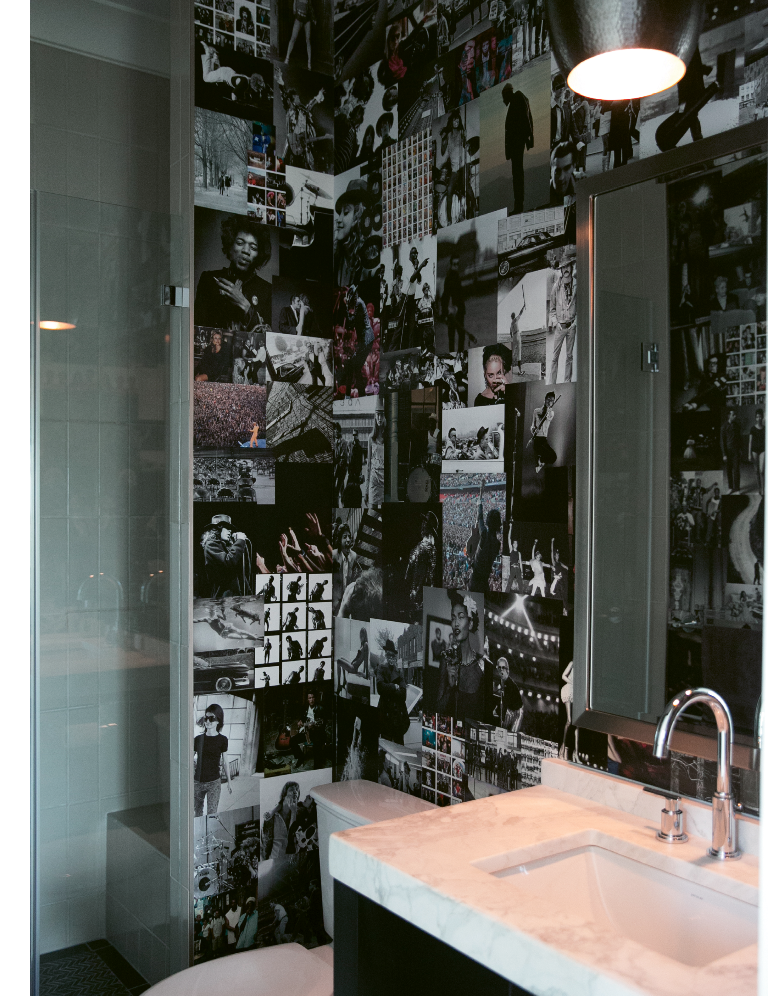 Melissa and Brad made the wallpaper in this first-floor bath themselves, using favorite photos of musicians they ripped from coffee-table books.