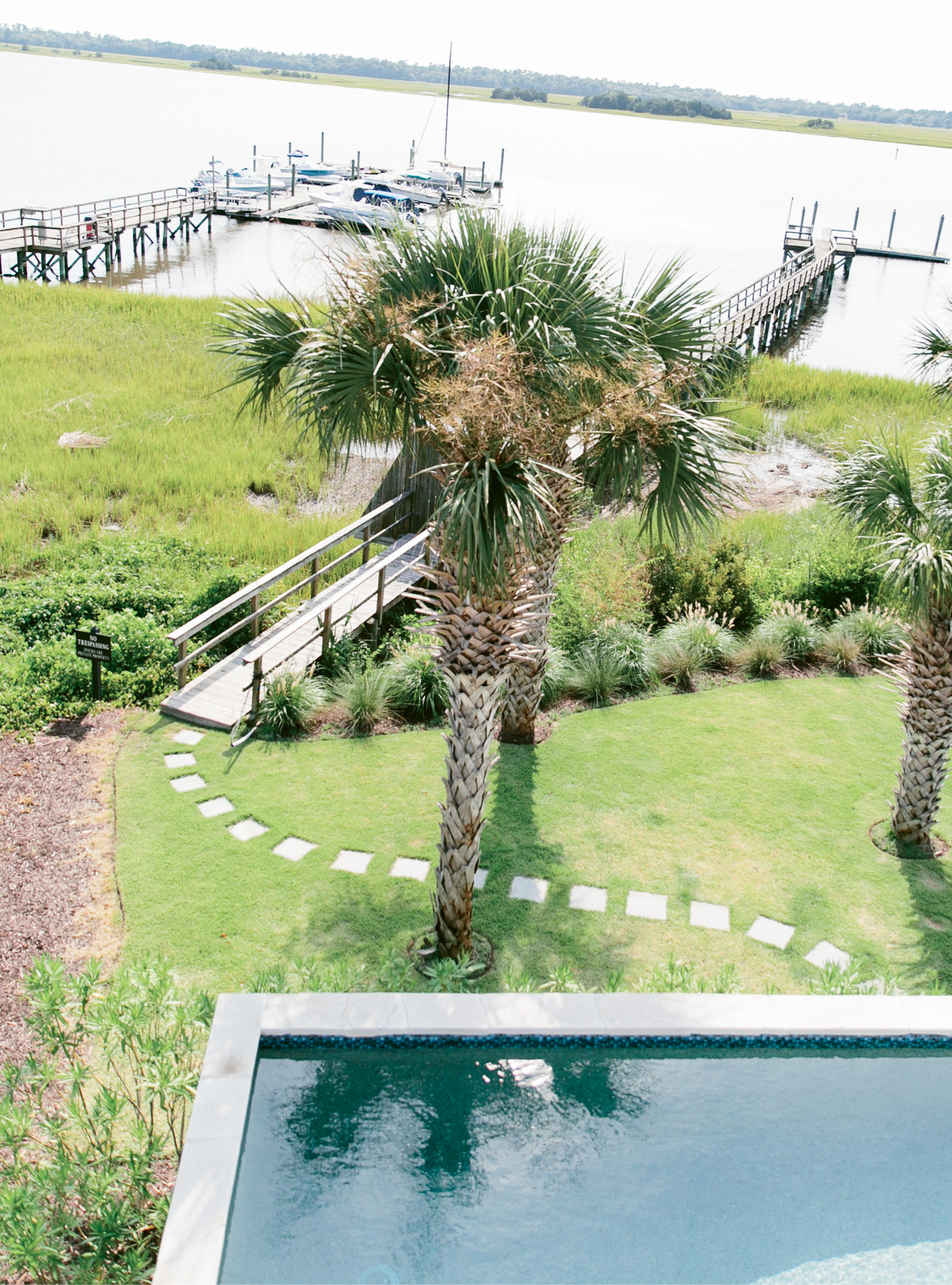 """Stone pavers lead from the pool to the family's dock. """"We're out there a lot; the kids fish and hang out,"""" Melissa says."""
