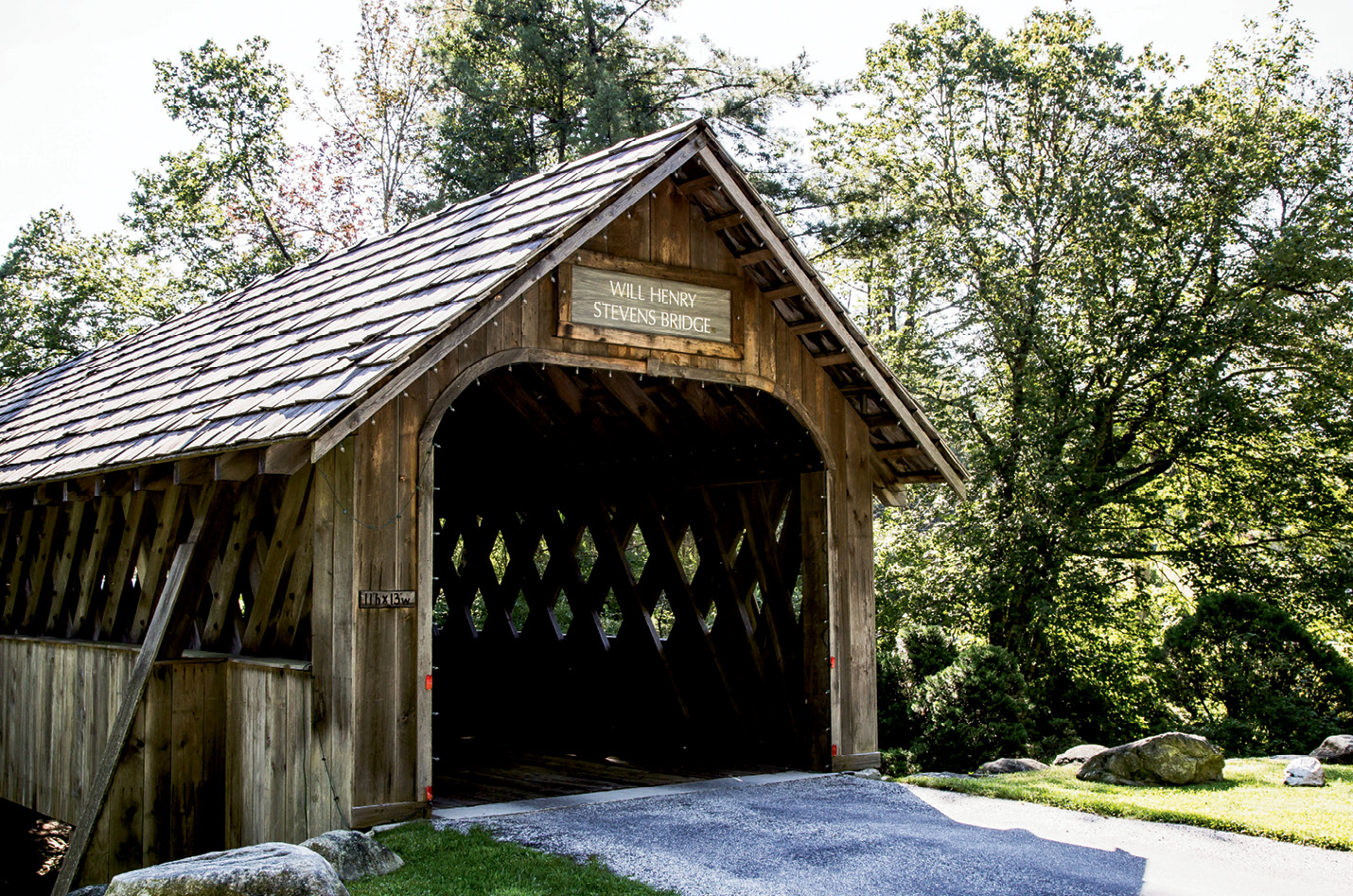The covered bridge entrance to The Bascom arts center is a reclaimed wooden structure named for artist Will Henry Stevens.