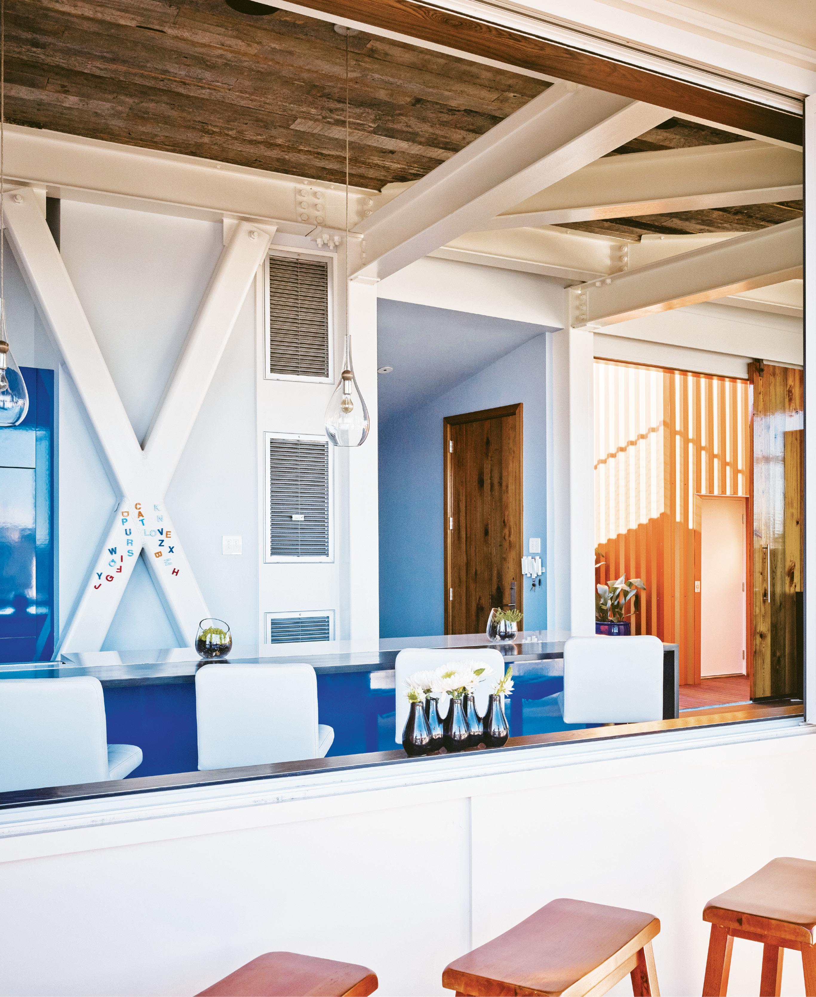 Custom acrylic cabinets in cobalt blue reflect Yessian's modern tastes.
