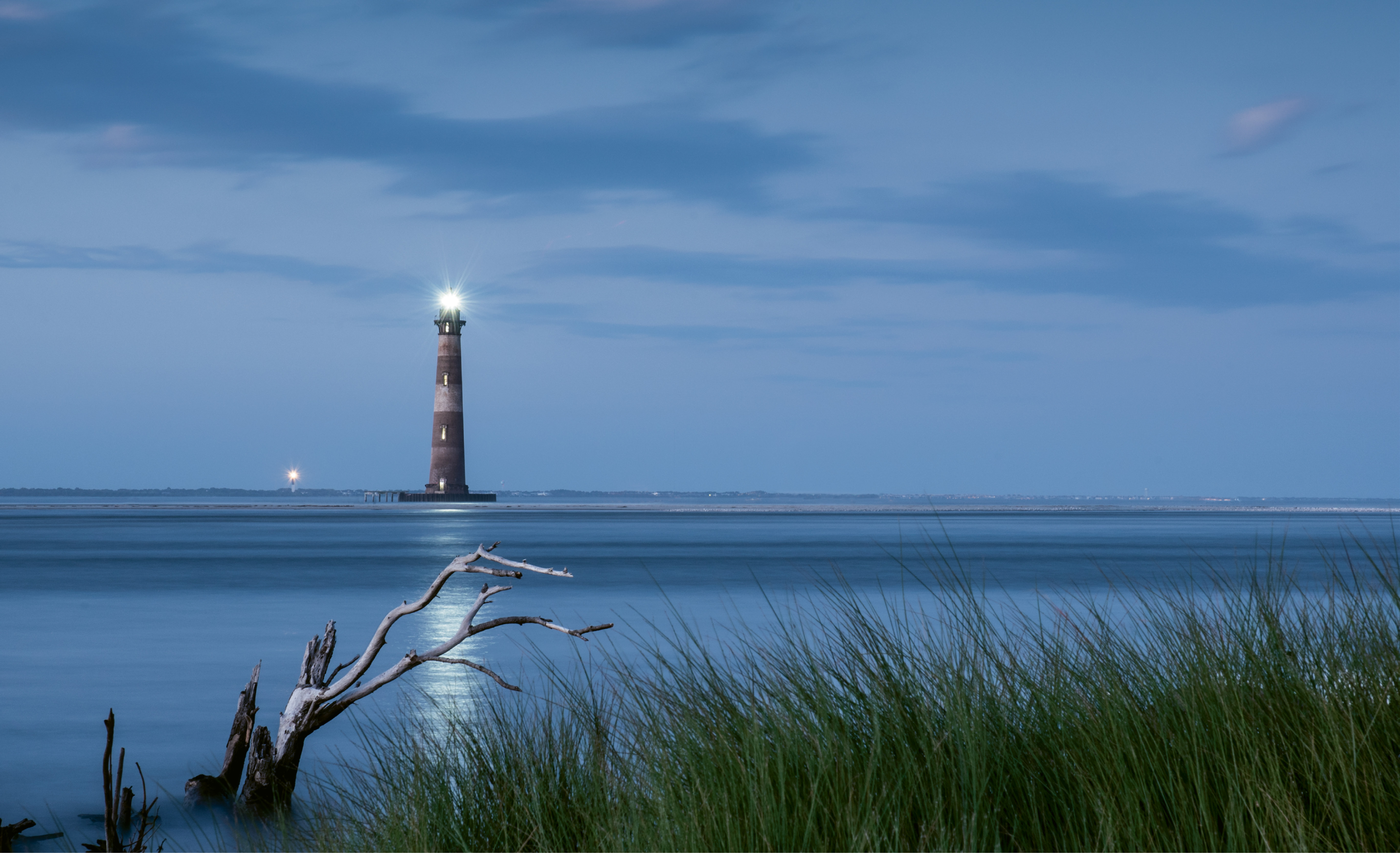Two Lights Burning by Charles Hooker  {Professional category} - The re-illumination of the Morris Island Lighthouse on October 1, 2016