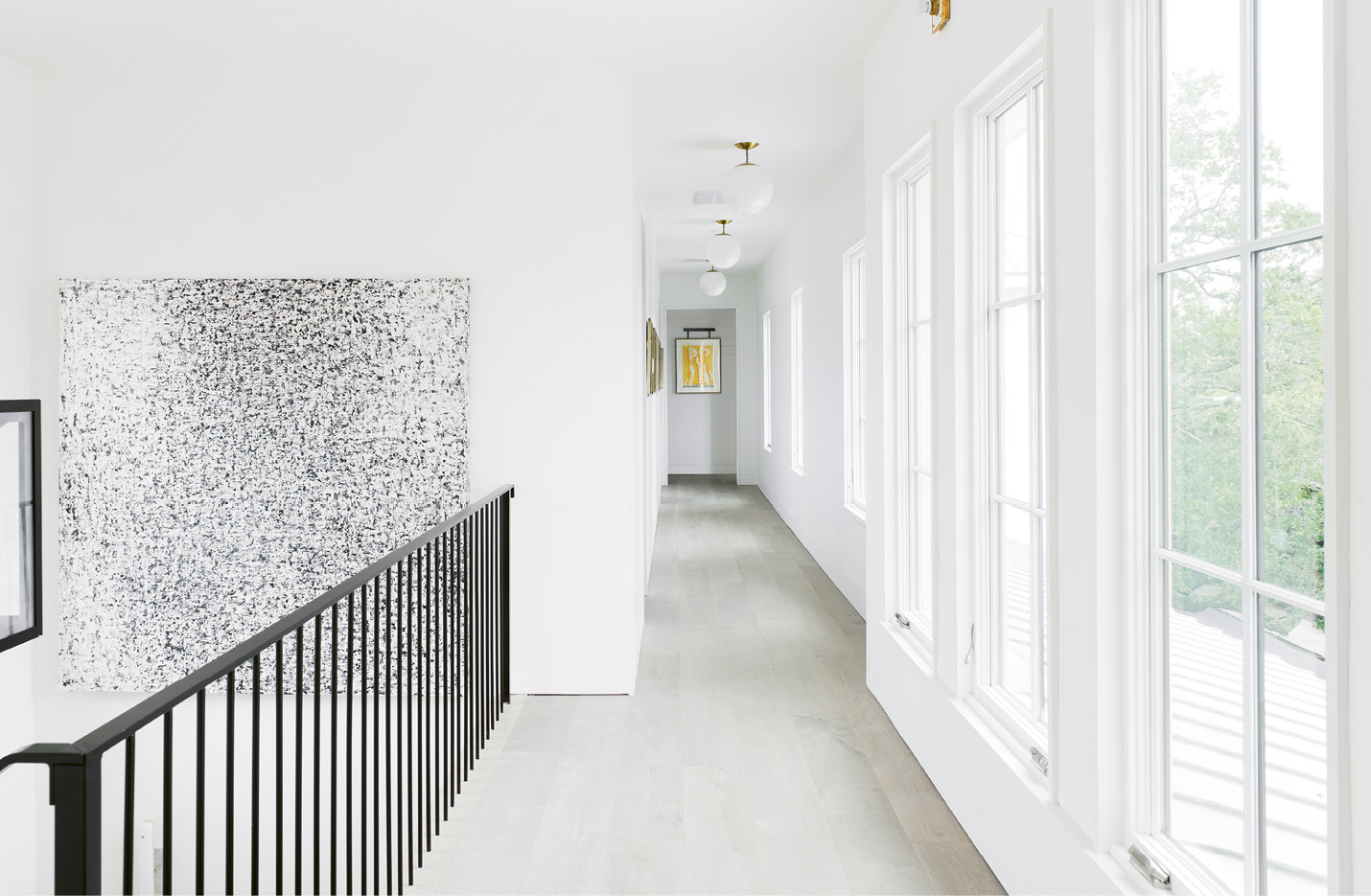 A custom black-and-white piece by Belgian artist Sabine Maes makes a statement in the upstairs hallway.