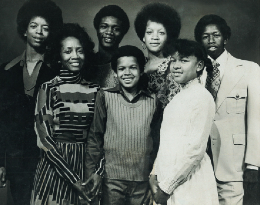 A proud mom with her six children (left to right) Ralph, Stanley, Darryl, Adrian, Jami, and Gerald