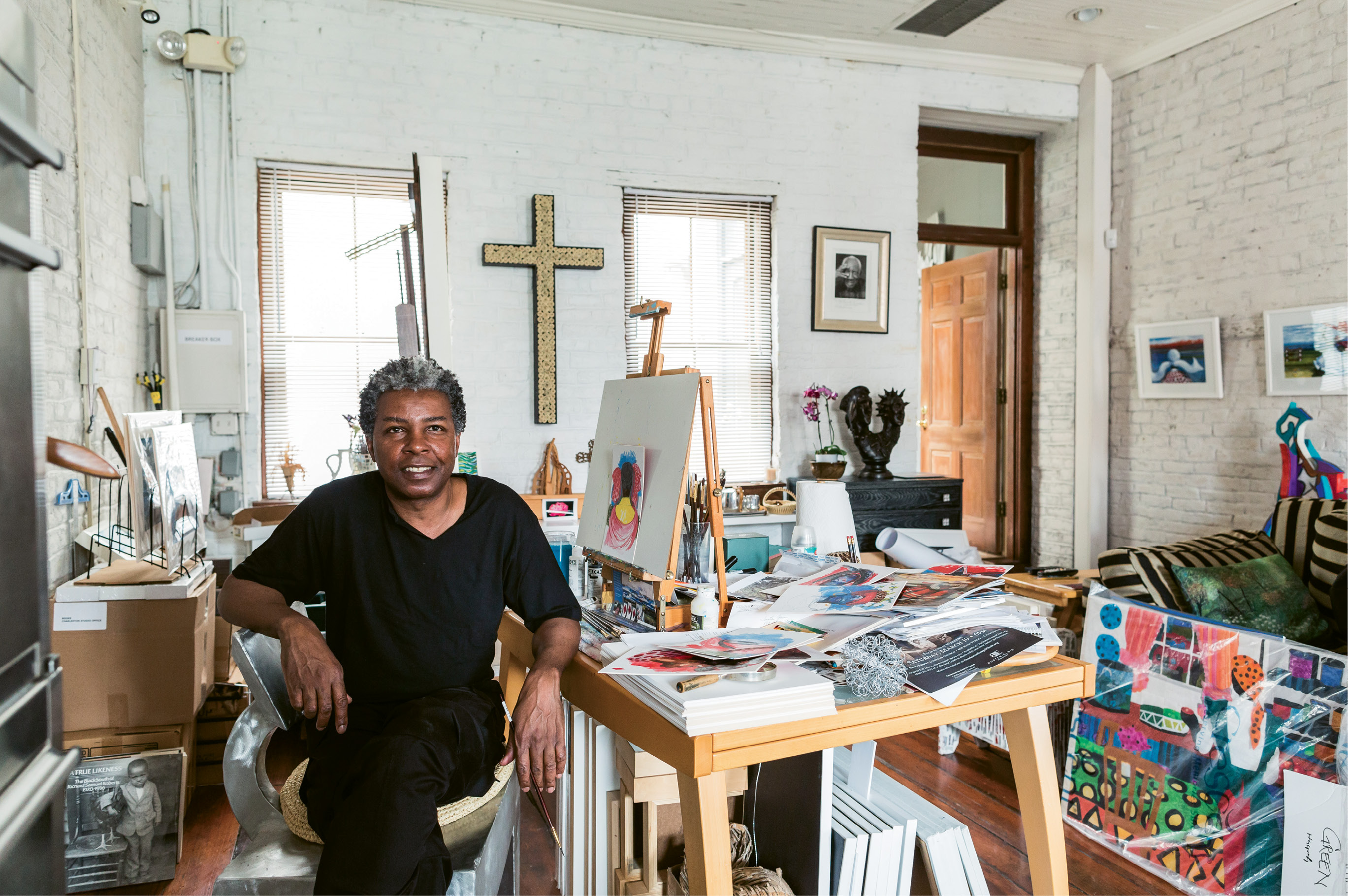 """Green, at work in his downtown studio, is dressed in what he calls his """"uniform"""" (always a black T-shirt and pants)."""