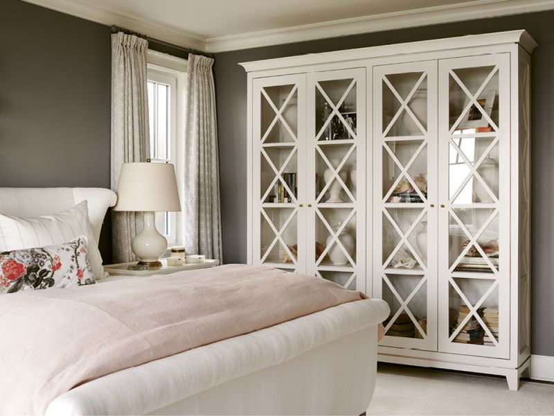 The custom bookcase holds mementoes, such as the conch shells Leah's skin-diving husband has been pulling up for her since their honeymoon.