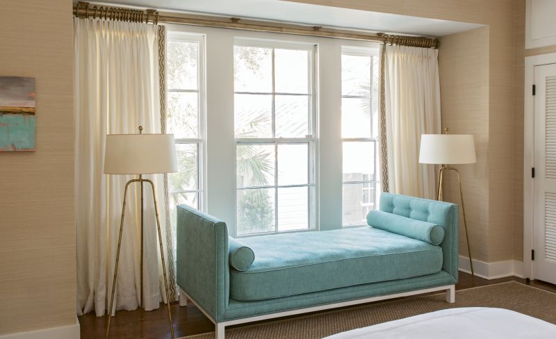 The custom settee in this guest room features a twin mattress covered in indoor/outdoor fabric, so it can pinch-hit as an additional guest bed.