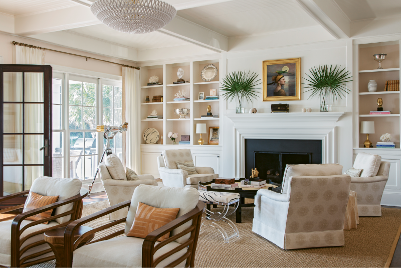 """COASTAL CHARM: The Kings asked designer Allison Elebash to infuse the home with a laid-back island vibe. For the living room, she chose a color palette inspired by coastal landscapes—the walls, for example, are Benjamin Moore's """"Beautiful in My Eyes,"""" a rosy hue inspired by the pink sand beaches of the Caribbean."""