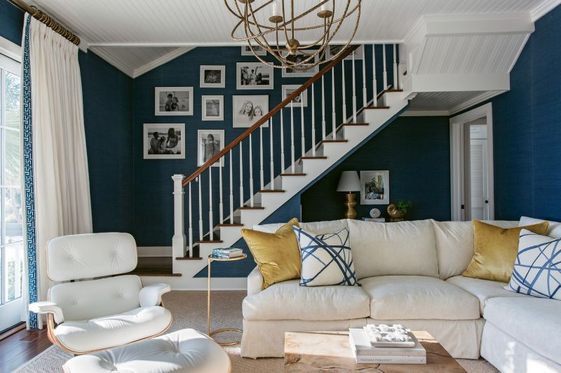 """BLUE ZONE: In the den, the Kings opted for grass-cloth wallpaper by Phillip Jeffries in a navy in keeping with the coastal color palette. """"It reminds me of the Mediterranean,"""" says Tara."""