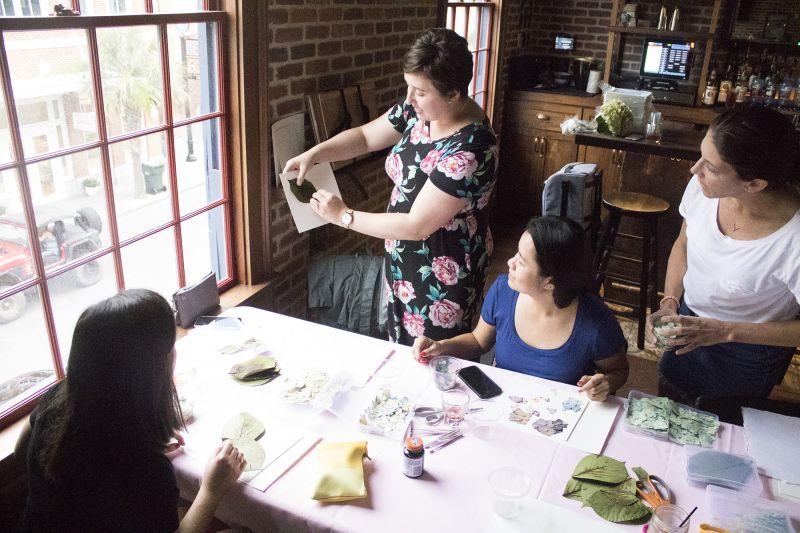 Lauren Whiteside Mann instructs Vanessa White and Marie Delcioppo.
