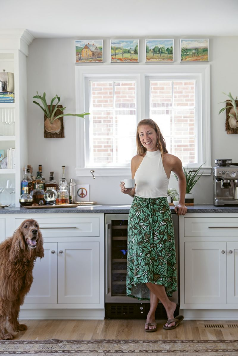"""HOME SWEET HOME: Rachel purchased the property in October 2016. Demolition began by late November, and the following April, she and her Irish setter, Sammy, moved in. """"In the last year, I've hosted Thanksgiving, a big Chanukah gathering, and my neighbors during the snow storm,"""" she says."""
