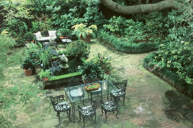 """ROOMS TO GO: Patti's Ansonborough garden, as photographed by Virginia Weiler for the September/October 2003 issue of Horticulture, featured three garden """"rooms,"""" two ponds, and bordered beds planted for interest every month of the year."""