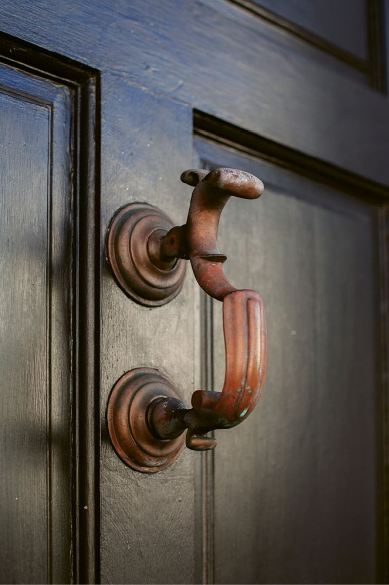 A physician's knocker, a style once used to identify the home of a doctor, graces the front door.