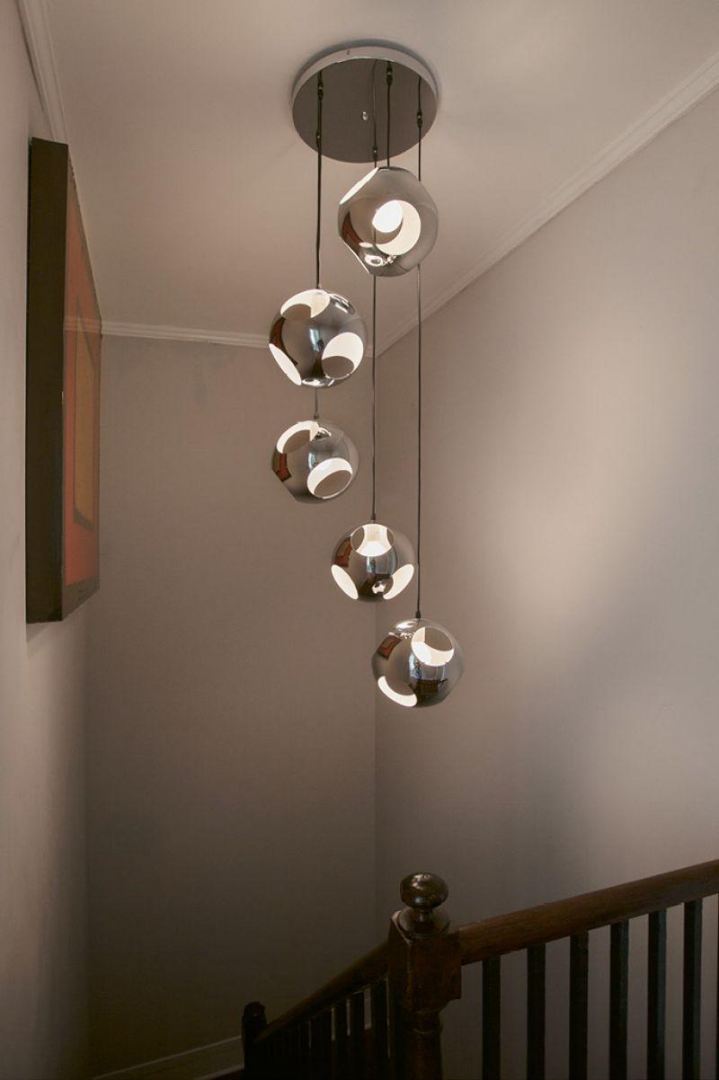 Naylor found the chandelier that illuminates the stairwell on eBay.