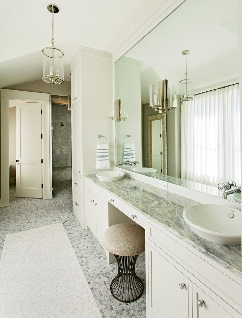 Waterworks fixtures and a Walker Zanger mosaic marble tile floor set an elegant tone in this bath.
