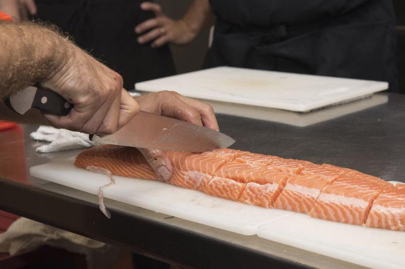 Chef Casciello demonstrates how to properly cut salmon.