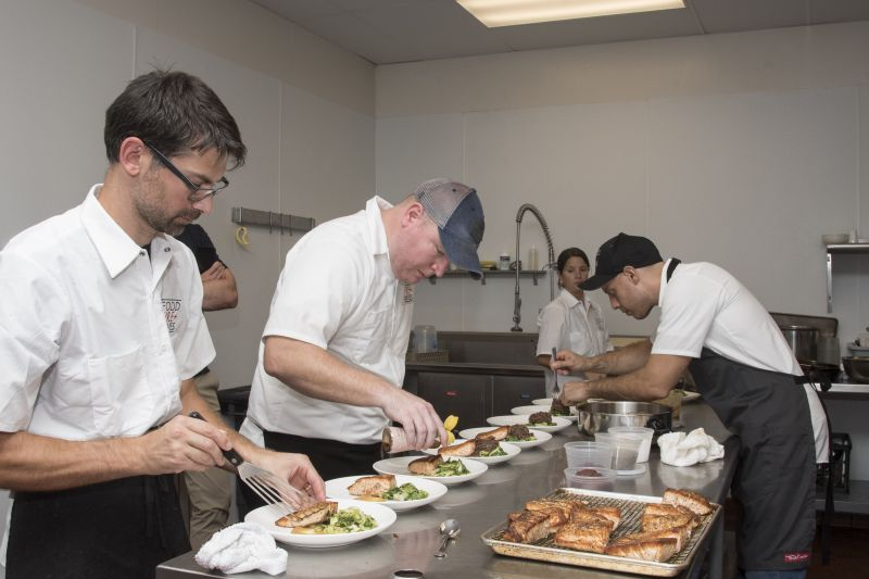 Chefs Pepe, McGarity, and Casciello assemble the second course.