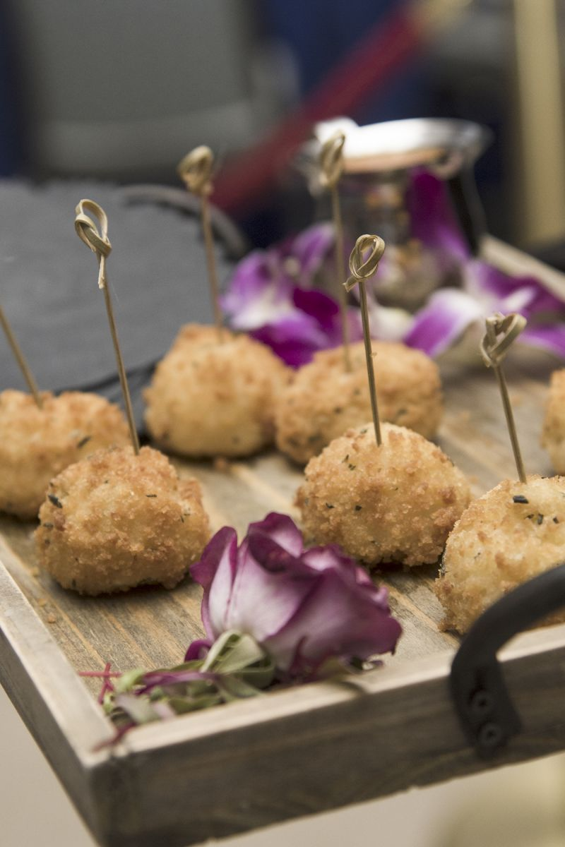 Guests could indulge in hors d'oeuvres such as these rice balls before sitting down for dinner.