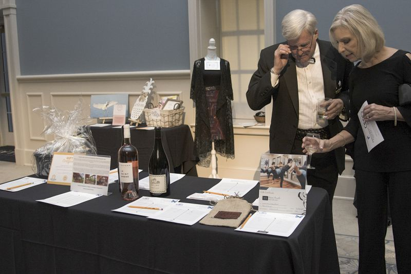 Guests participate in the silent auction during cocktail hour.