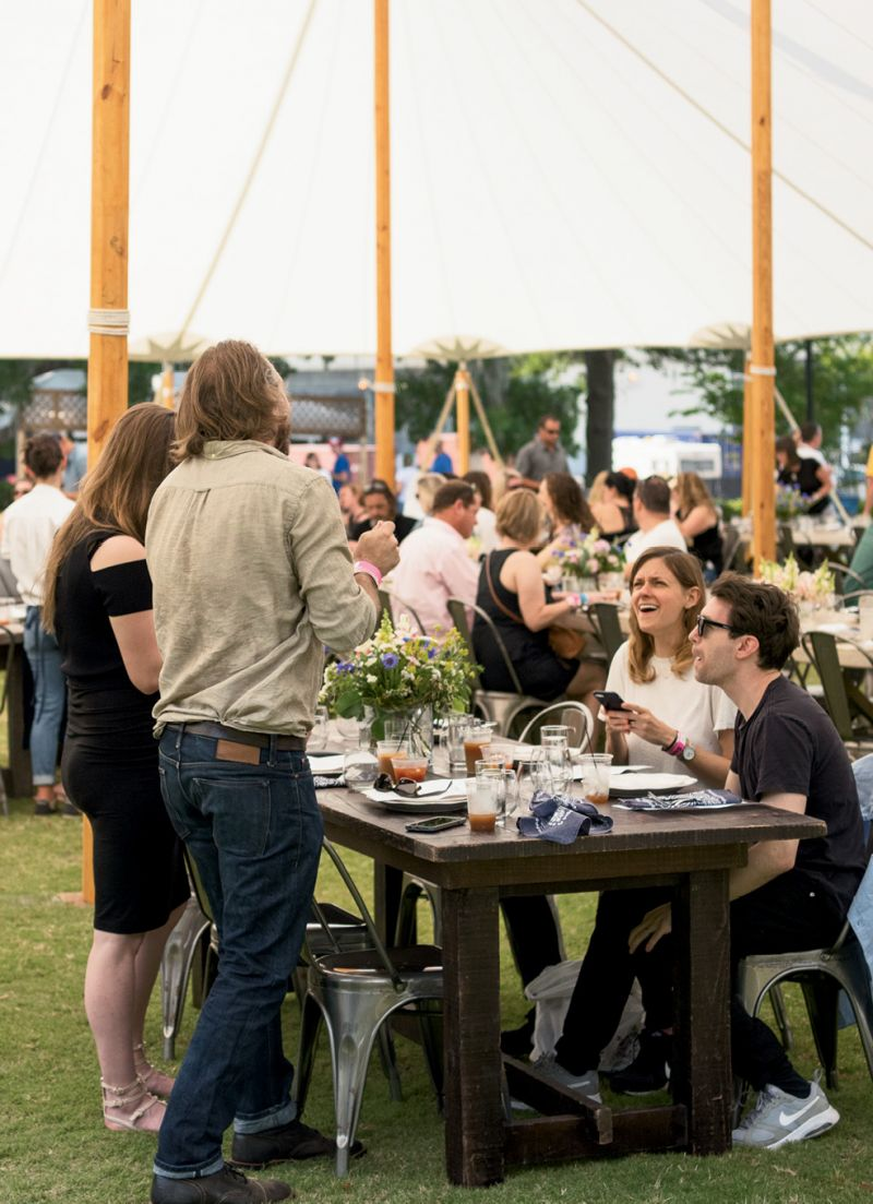 Guests mixed and mingled at community tables.