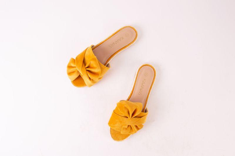 "Kaanas espadrille slide-ons in ""marigold,"" $108 at Maris Dehart"