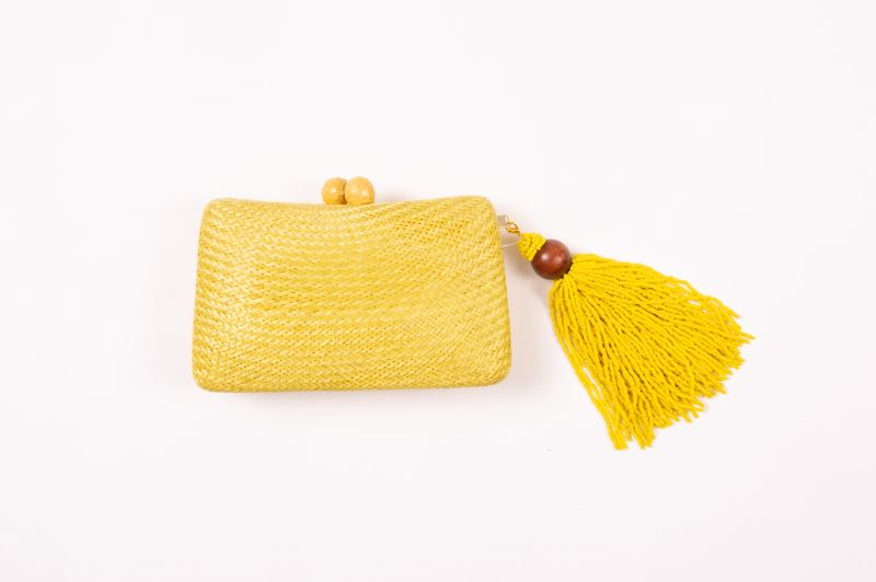 "Serpui ""Charlotte Bun"" straw clutch, $238 at Berlin's for Women"