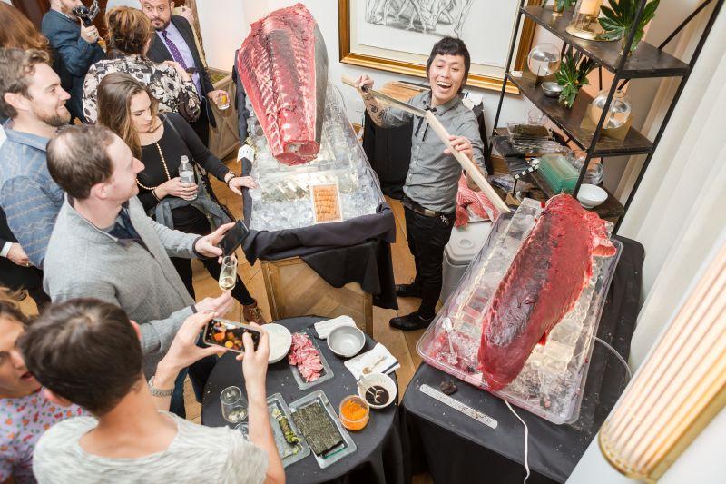 A sushi artist serves up fresh hand rolls