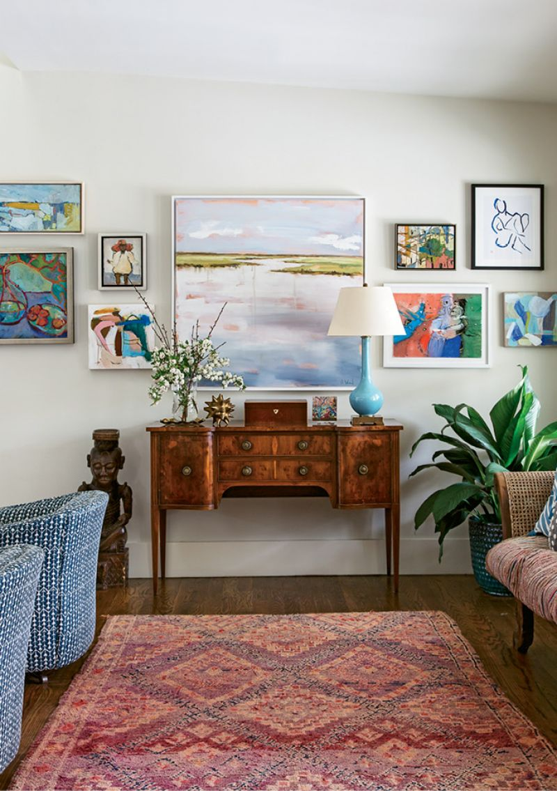"Changing Scenery: This gallery wall in the living room is always in flux. ""I constantly change it out,"" Allison says. Works by Charleston Artist Collective members dominate this iteration, including pieces by Shannon Wood (center) and Lynne Hamontree (top right)."