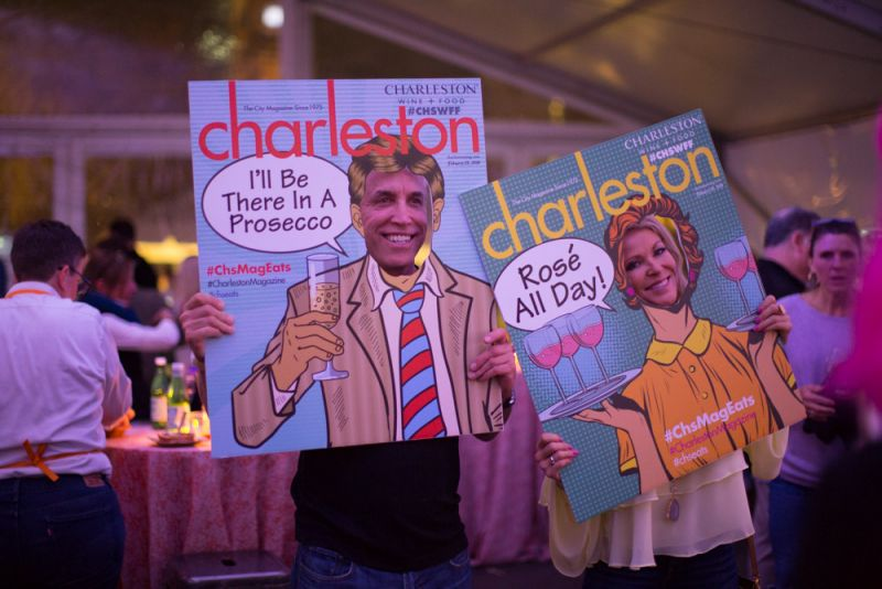 Guests snag a photo with Charleston magazine's pop art props.