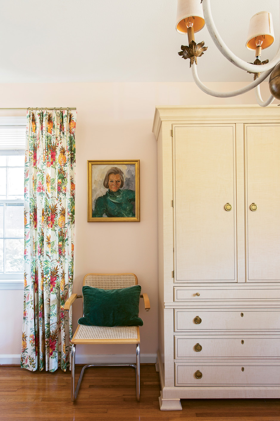VINTAGE VIBE: In Tinkler's home office, an antique Drexel armoire provides a handsome home for paperwork. Caned chairs, botanical textiles, and an antique portrait in a gilt frame lend a laid-back glamour to the work space.